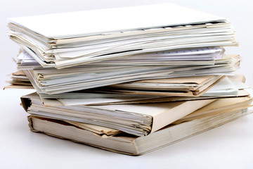 a stack of documents on white background