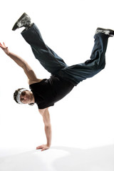hip-hop style dancer posing on a white background
