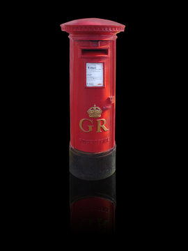 British red letterbox in england on a black background