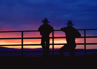 grandson and grandfather at sunset