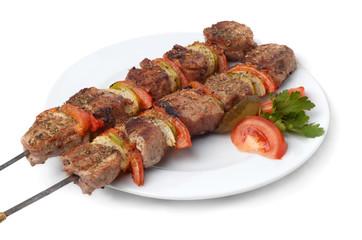 weal kebab on skewers, isolated on white