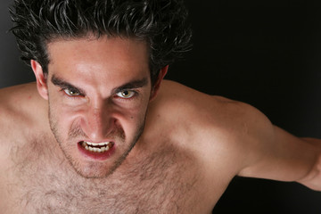 Young man with furious facial expression