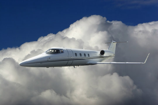 Lear Jet in the Clouds