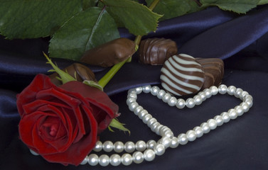 rose withe candies and pearls