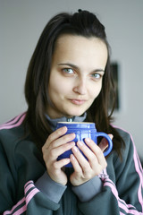 An attractive female having a cup of tea or coffee