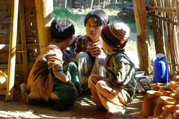 asian children in wooden house