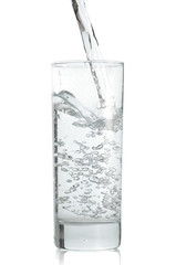 Water poured  to the glass on a white background