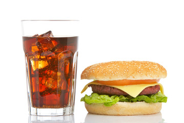 Burger and soda, reflected on white background. Shallow DOF