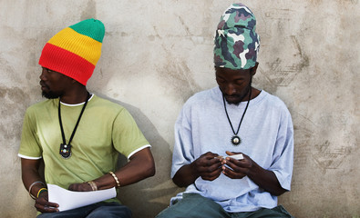 Rastafarian men smoking cannabis