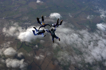 Skydivers building a formation