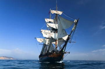 HMS Surprise Sailing Ship at Sea under full sail