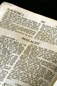 holy bible open to the book of Malachi in the old testament