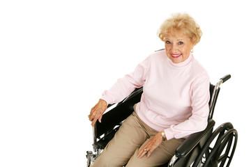 Pretty senior woman with positive attitude in a wheelchair.