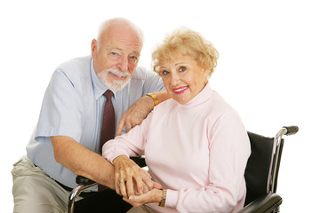 Attractive senior couple - the wife is in a wheelchair.