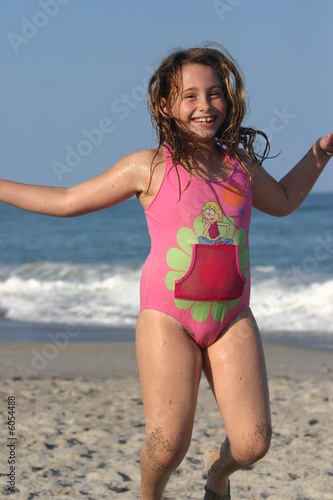 """little girl jumping at the beach"" Stock photo and royalty ..."