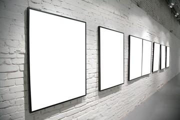 frames on brick white wall