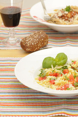 two plates with healthy pasta meals