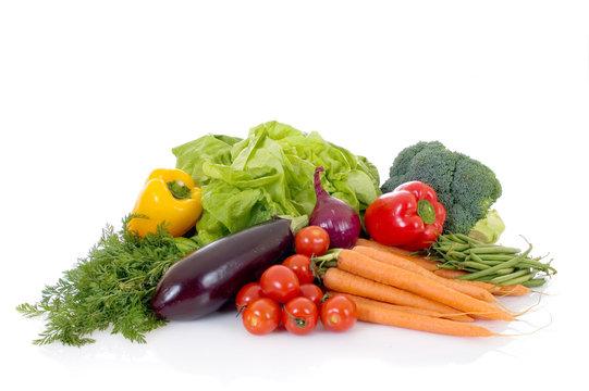 Fresh bio vegetables, white background, reflective surface