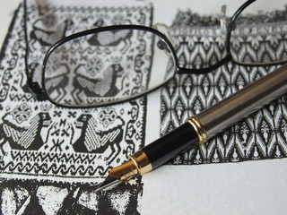 Glasses and Gold Pen On Ink Drawing