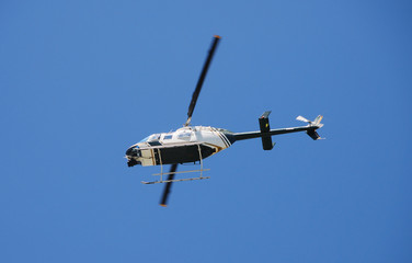 Bottom view of helicopter in flight