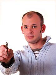 Young man holding a key