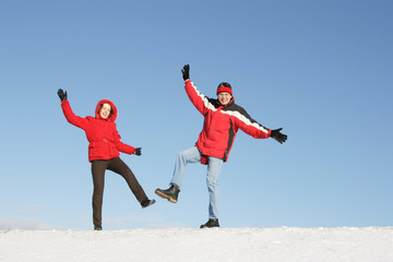 Couple have fun on snow in winter
