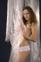 erotic girl packed in plastic