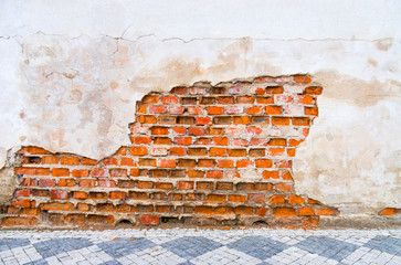 Brick wall with big dent. Texture or background.