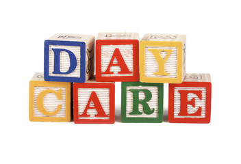 Abc blocks lined up to spell the word daycare - isolated