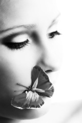 beauty portrait of a woman with butterfly