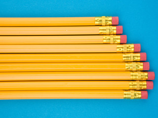 Yellow pencils on blue background