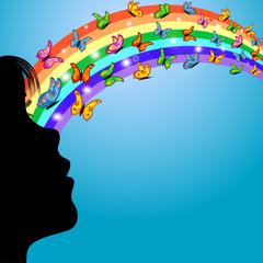 niña mirando arcoiris bajo un cielo azul