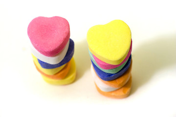 2 stacks of Valentine Candy Hearts
