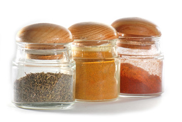 Jars with spices isolated against white background