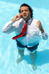Wet Businessman speaking on the Swimming Pool
