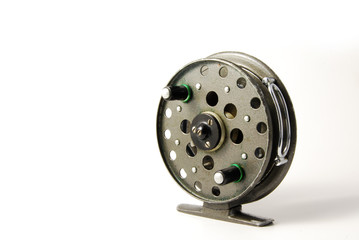 An old fishing reel on a white background
