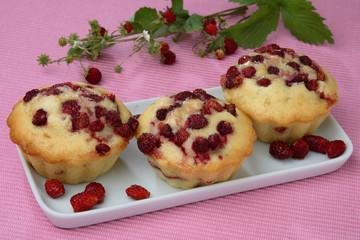 Three wood strawberry muffins on plate