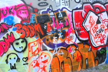 Graffiti on a city wall outdoors.