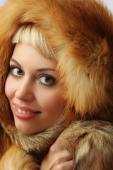 Portrait of the nice girl in fur