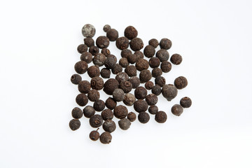 allspice balls isolated against a white background