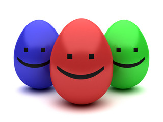 three color smiling easter eggs isolated on white
