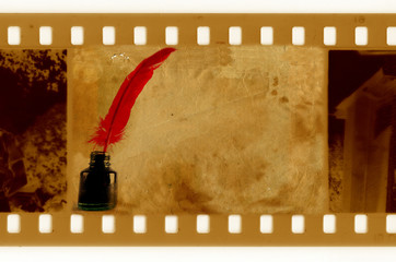 old 35mm frame photo with vintage inkwell and feather