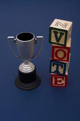 Trophy with vote alphabet blocks