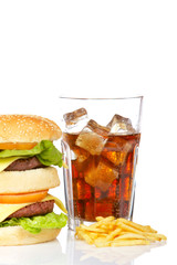 Hamburger and soda, reflected on white background. Shallow DOF