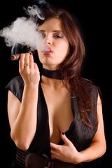 Beautiful woman smoking a cigar and blowing smoke