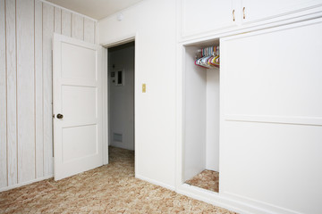 Empty room with white walls and wardrobe closet