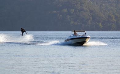 waterskier jumps into air behind fast speedboat  Wall mural