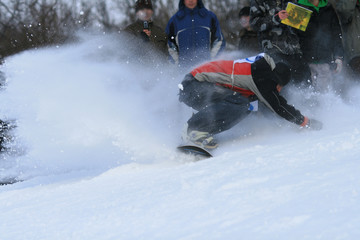 Falling of sportsmen on a snow slope of mountain