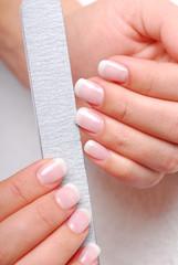Beauty salon. Polishing of nails with the nailfile.