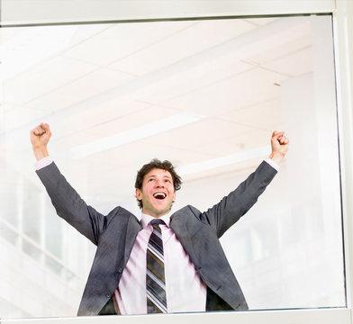 Happy businessman celebrating success